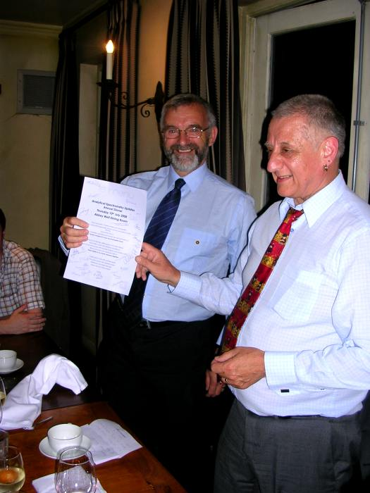 Presentation of a signed menu to Dr Phil Potts